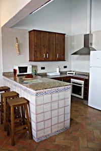 A kitchen or kitchenette at Casa Rural Elanio Azul