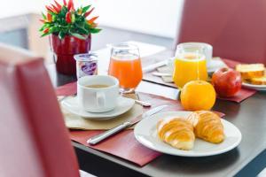אפשרויות ארוחת הבוקר המוצעות לאורחים ב-Lagrange Apart'Hotel Strasbourg Wilson