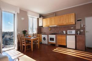 A kitchen or kitchenette at Milan Skyline Apartment