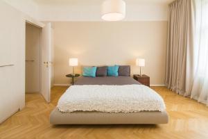 Un ou plusieurs lits dans un hébergement de l'établissement Luxury Apartments D22