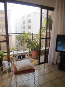A seating area at Apartamento Vista Mar - 2 Vagas