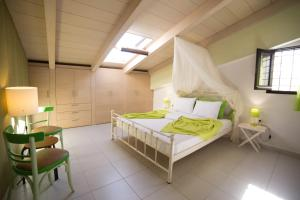 A bed or beds in a room at AC Homes Christos