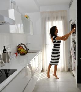 A kitchen or kitchenette at Pura Vida Beach Suites