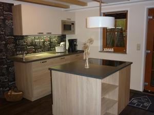 Küche/Küchenzeile in der Unterkunft Ferienwohnung Lämpelberg