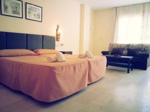 A bed or beds in a room at Aguas Salinas