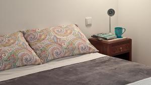Llit o llits en una habitació de Duque´s Apartments
