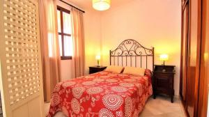 A bed or beds in a room at Holi-Rent Carretería
