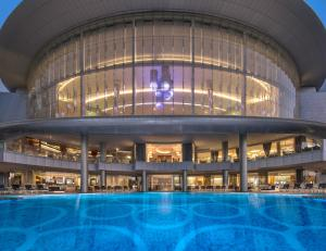 The swimming pool at or near Jumeirah at Etihad Towers Residence