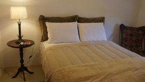 A bed or beds in a room at POA Para Executivos
