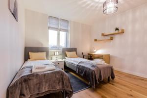 Voodi või voodid majutusasutuse Pronksi 3 Apartments toas