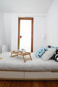 Łóżko lub łóżka w pokoju w obiekcie Aquarius Apartment