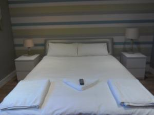 A bed or beds in a room at The Dorchester Serviced Apartments