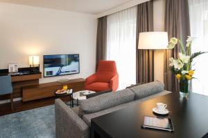 Uma área de estar em Fraser Suites Geneva - Serviced Apartments