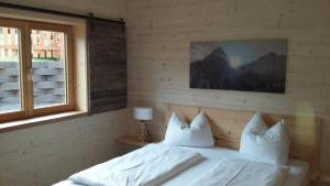 A bed or beds in a room at Appartements Alpenland