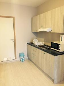 A kitchen or kitchenette at Prestige Flats