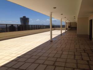 Een balkon of terras bij Flat Ed Praia Dourada