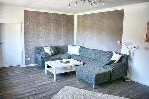 Ein Sitzbereich in der Unterkunft Ferienhaus Drewitz (EOC-FUP 07/2017)