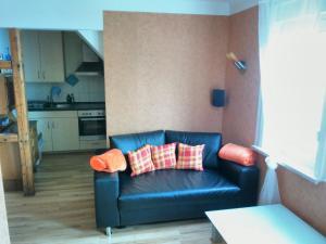 Ein Sitzbereich in der Unterkunft Oberhof Apartment