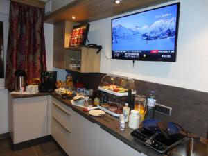 A television and/or entertainment center at Chasa Allegria