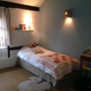 Un ou plusieurs lits dans un hébergement de l'établissement Belle Chaumiere Normande De 300 Ans