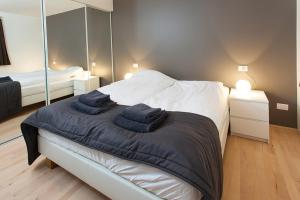 A bed or beds in a room at Villa - South Iceland