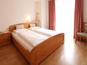 Uma cama ou camas num quarto em Residence Rose