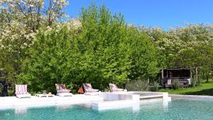 The swimming pool at or near Mandarina Suites