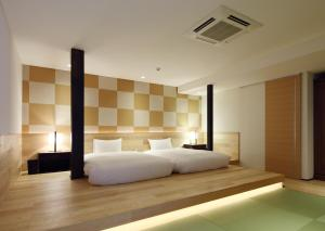 A bed or beds in a room at Kyoyado Usagi