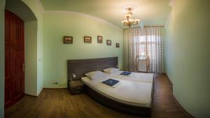Postel nebo postele na pokoji v ubytování Apartment Elizaveta