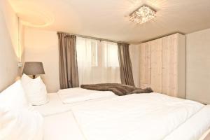 Ein Bett oder Betten in einem Zimmer der Unterkunft Ferienhaus Ostseerausch