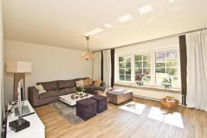 Ein Sitzbereich in der Unterkunft Ferienhaus Ostseerausch