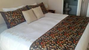 Cama o camas de una habitación en Santiago Neighborhood