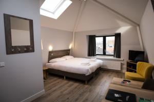 A bed or beds in a room at UtrechtCityApartments – Weerdsingel