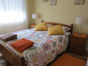 A bed or beds in a room at Casa da Corredoura