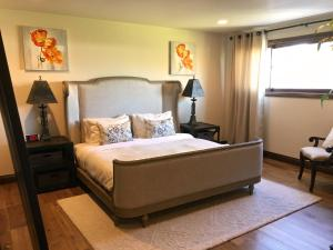 A bed or beds in a room at Selby Ave Guest House