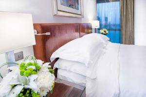 A bed or beds in a room at Burjuman Arjaan by Rotana - Dubai