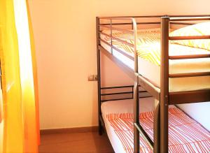 A bunk bed or bunk beds in a room at Lloret Beach Apartments