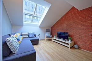 Ein Sitzbereich in der Unterkunft NABO apartments
