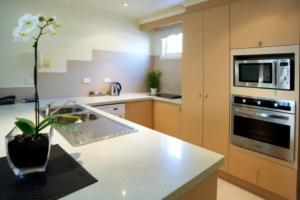 A kitchen or kitchenette at Quest Royal Gardens