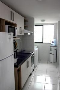 A kitchen or kitchenette at Apartamento Green Park