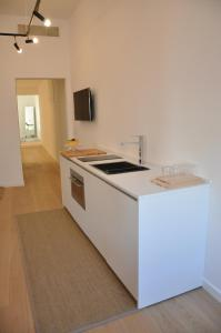 A kitchen or kitchenette at Appartamento Colonna