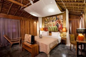 A bed or beds in a room at Alami Boutique Villas & Resort