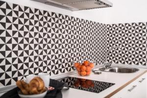 Una cocina o zona de cocina en Apartamentos Campo Del Príncipe