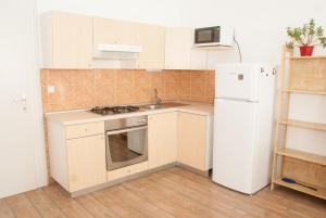 Kuhinja oz. manjša kuhinja v nastanitvi Apartment Bon Voyage