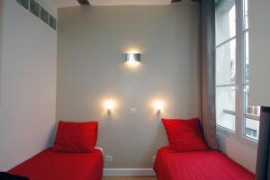 A bed or beds in a room at HolidaysInParis-Bourg Tibourg II