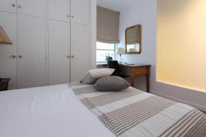 Lova arba lovos apgyvendinimo įstaigoje Apartamento Tosca Deco