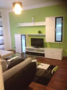 Ein Sitzbereich in der Unterkunft Apartment Helios