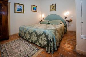 A bed or beds in a room at Residence Porta Antica