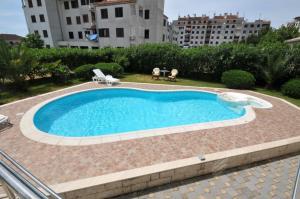 The swimming pool at or near Apartments Villa Lida