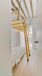 A bunk bed or bunk beds in a room at MyFlats Luxury City Center